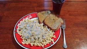 Hubby's plate of stroganoff with a side of garlic bread.