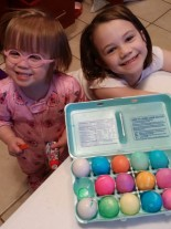 Lydia and Emma coloring Easter Eggs.