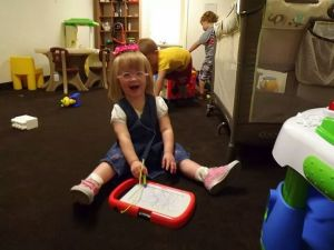 Emma playing in the church nursery. The smile on her face says it all.