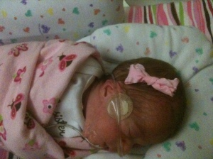 One of Emma's first bows. Thanks, Nurse Tiffany!