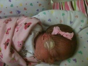 One of Emma's first bows. Thanks, Nurse Tiffany!